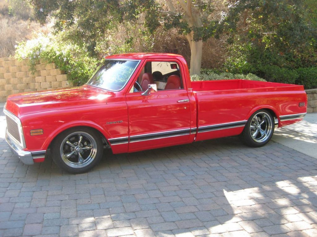 Brightly shining red 1969 Chevrolet C-10 1/2 Ton Long Bed Retro rod